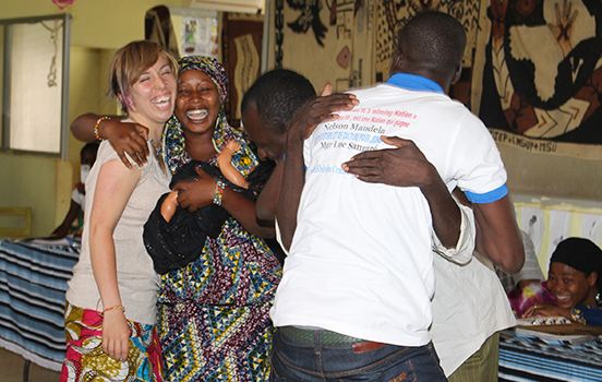 Students embracing local people in Tanzania