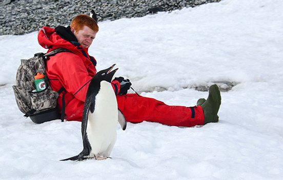 Student researching penguins in Antarctica